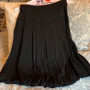 BCBC Maxazria black stretchy skirt with pleats